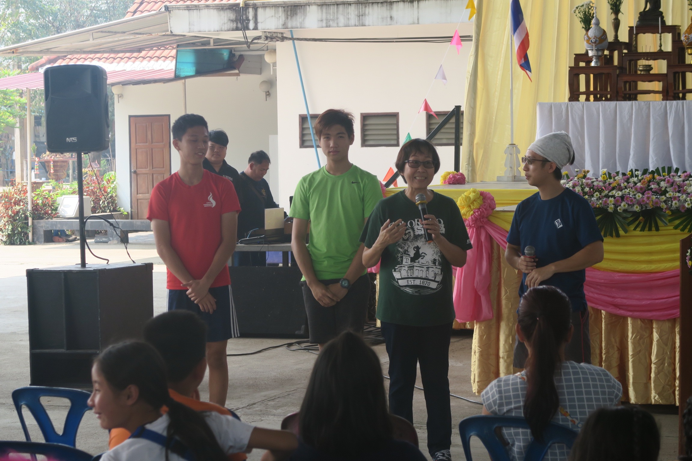 Preparing a skit on the gospel at a community carnival.