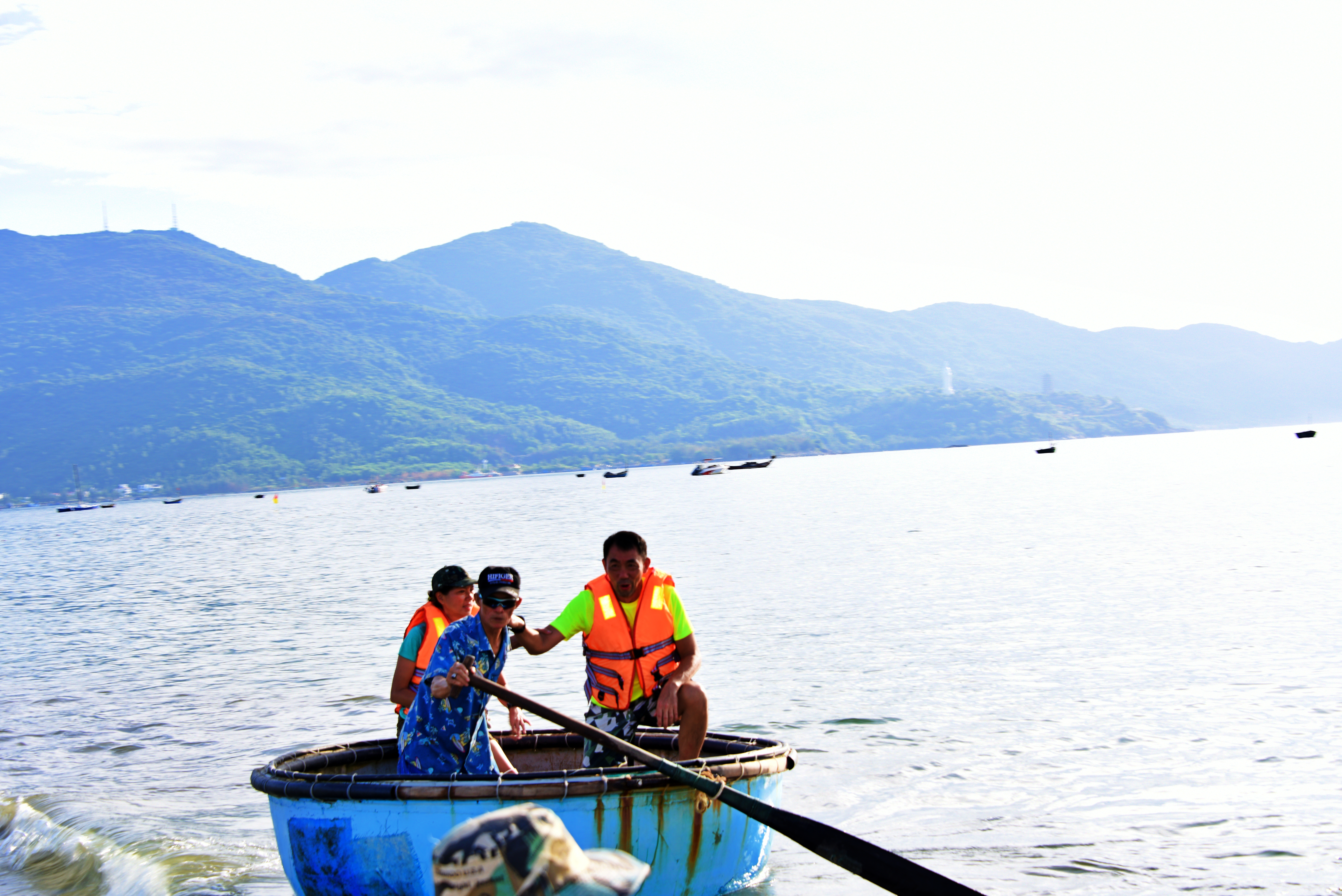 Tuck Meng steering the local fishing boat