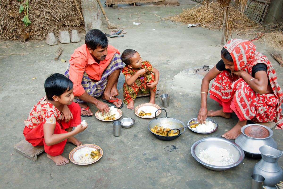 A Bangladesh World Vision sponsored child and her family having lunch at home