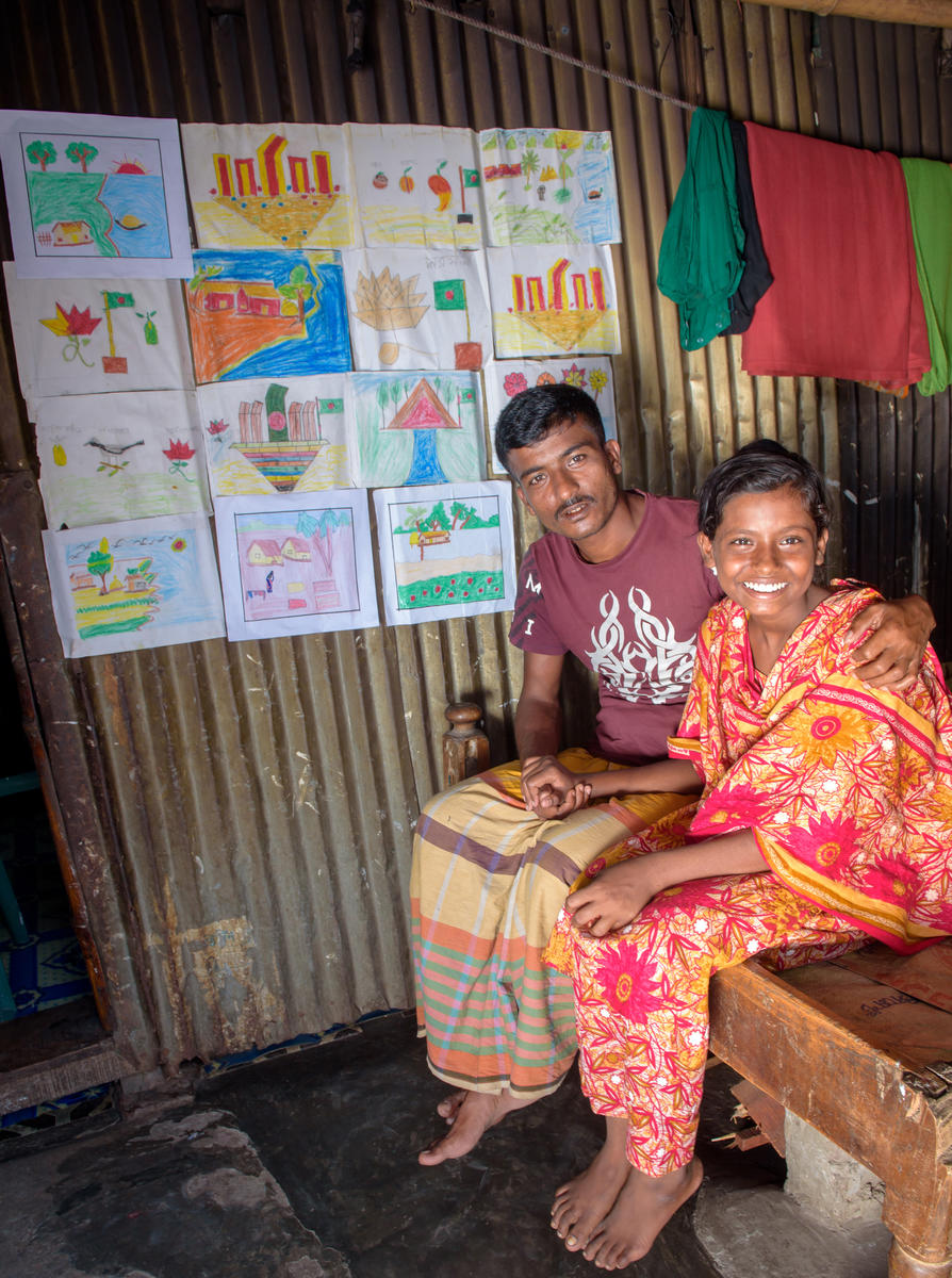 A World Vision Beneficiary and her father in Bangladesh's traditional outfits