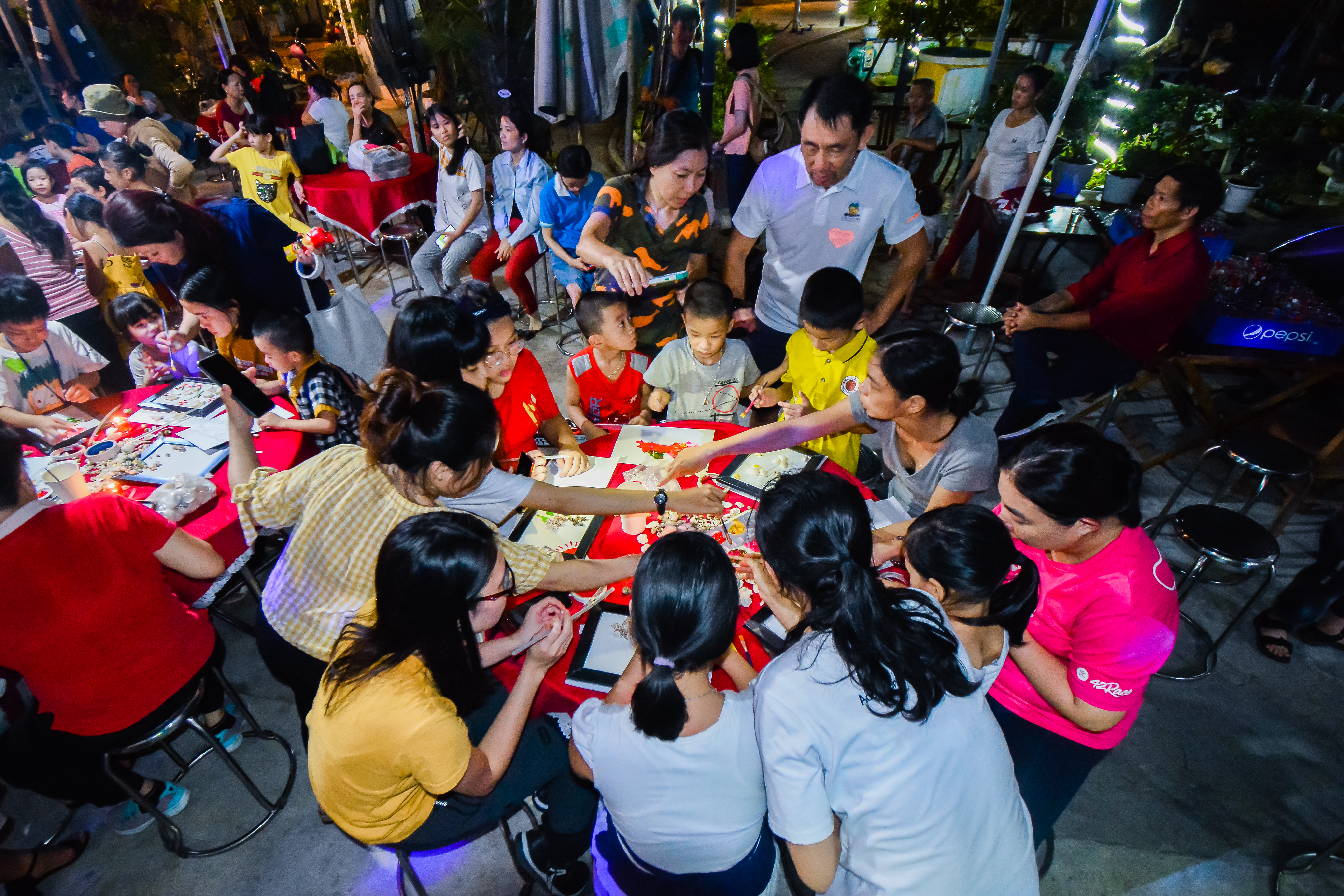 Sponsors and children partaking in activities together
