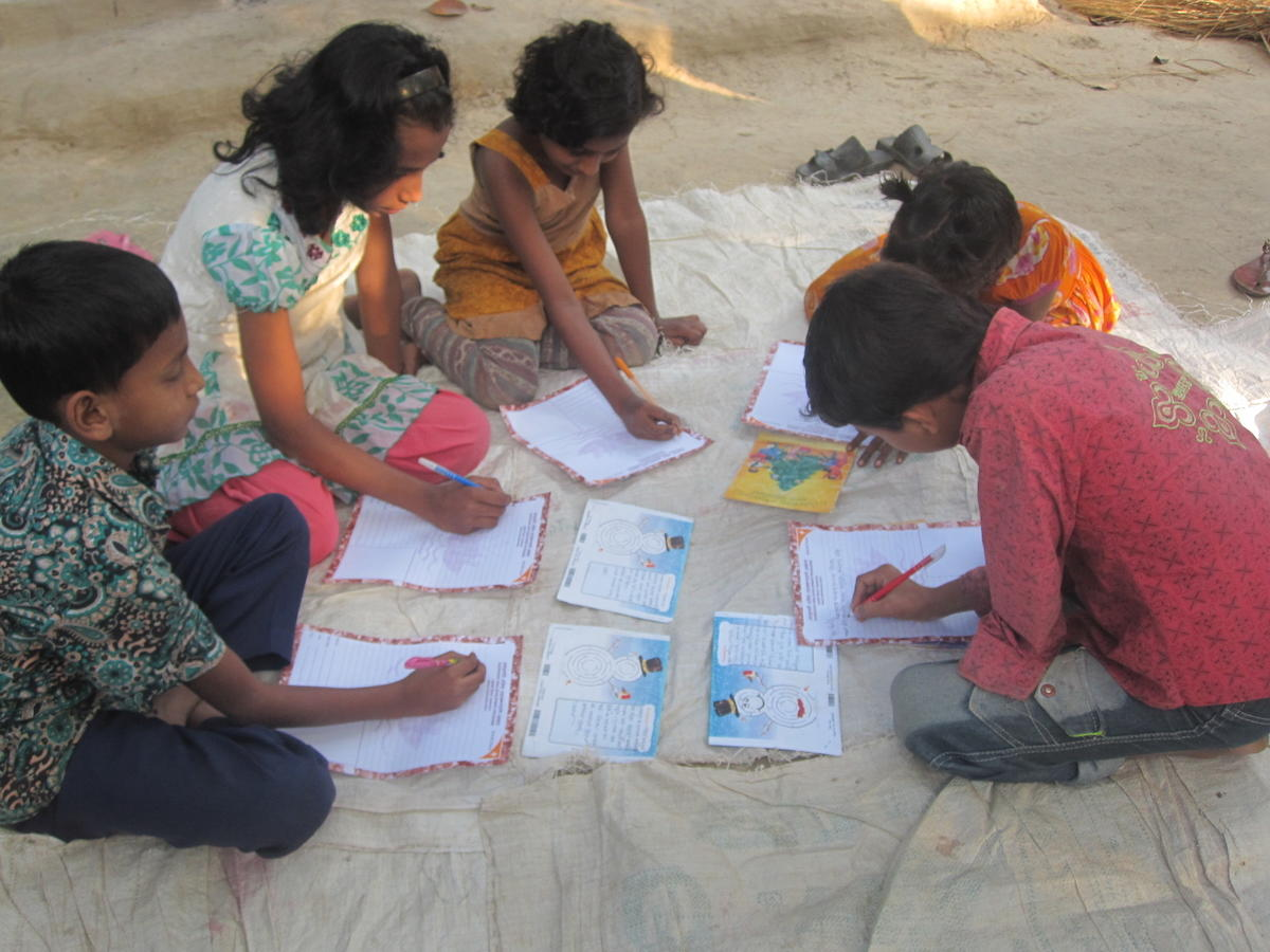 Children working on their reply letters as a group