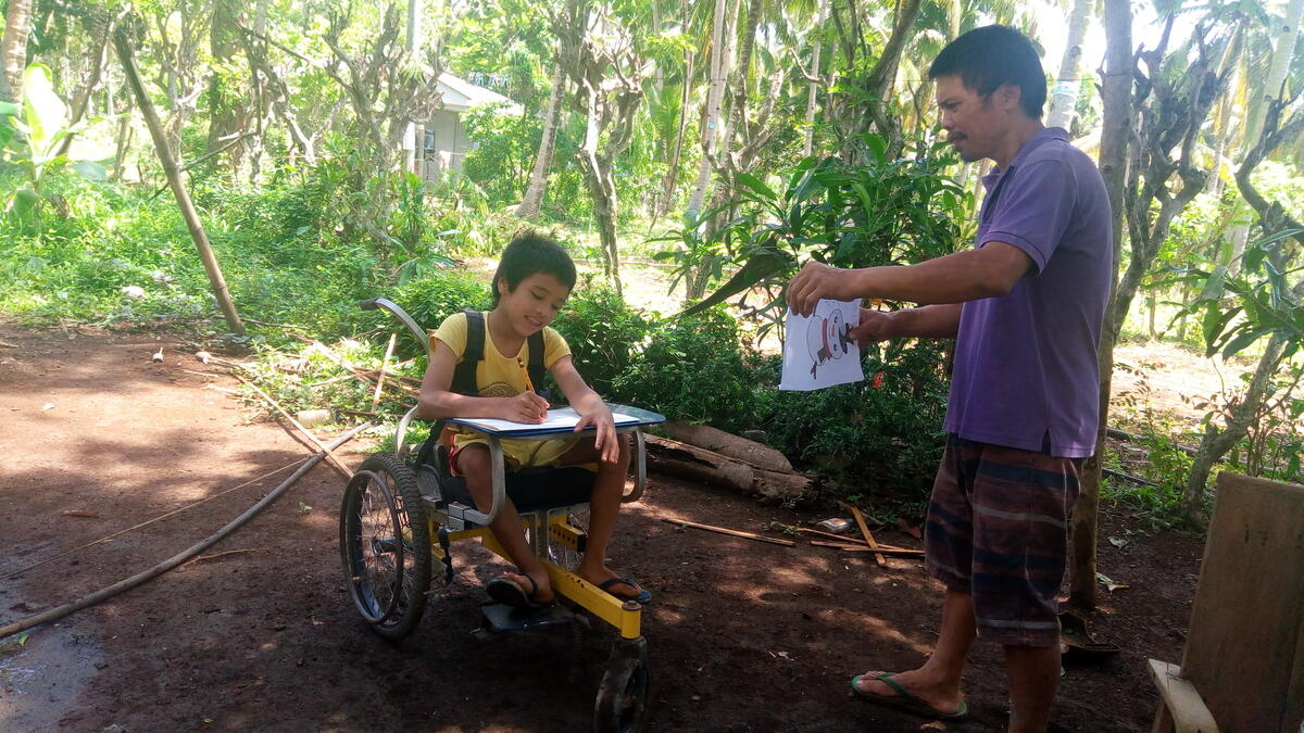 A child born with cerebral palsy adapting to learning from home