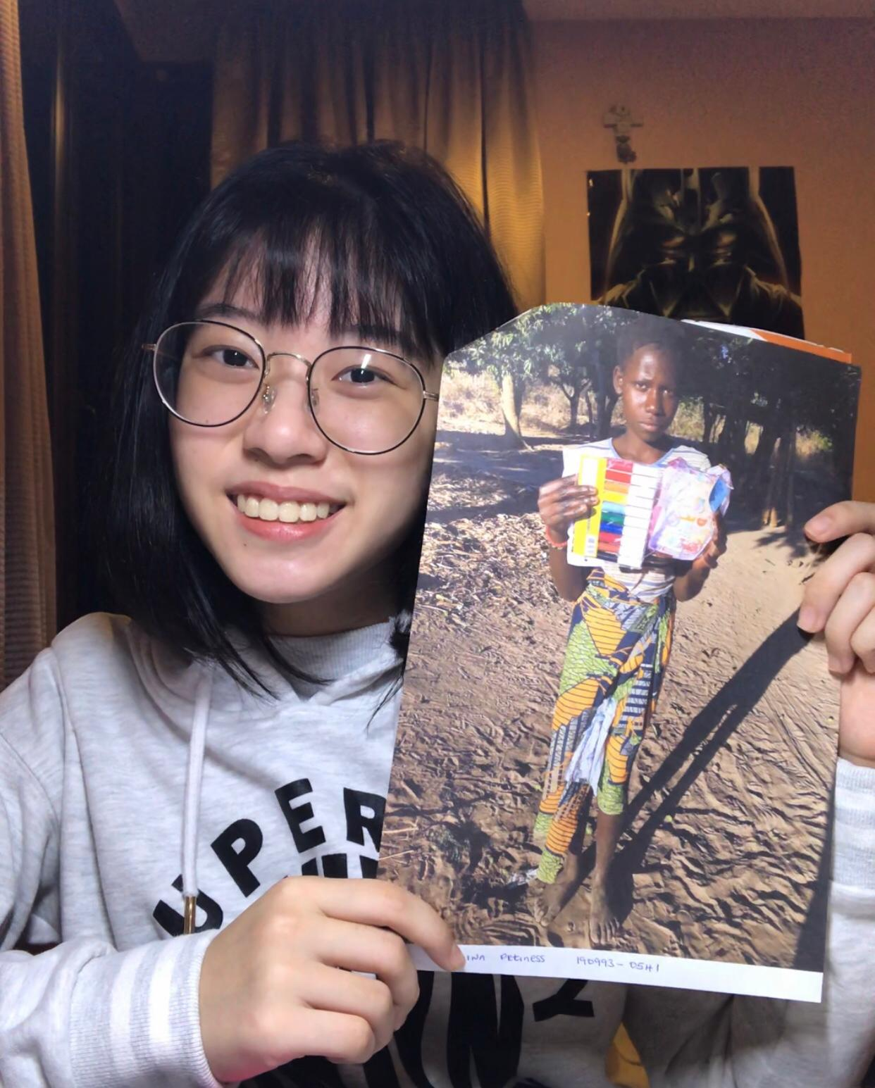 Andrea with a photo of Petiness and the gift she sent