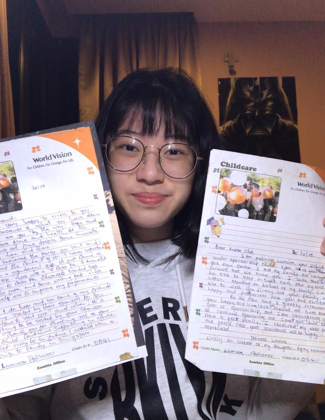 Andrea with reply letters from Petiness
