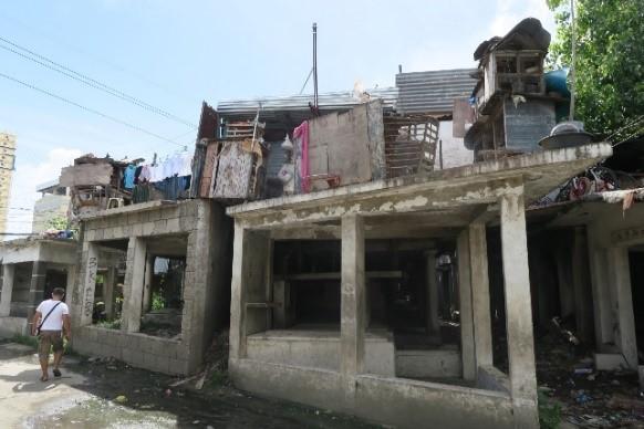 Informal settlers in Cebu set up makeshift homes in cemetaries.