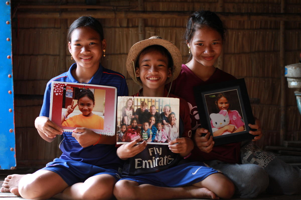Sponsored children with gifts from their sponsors